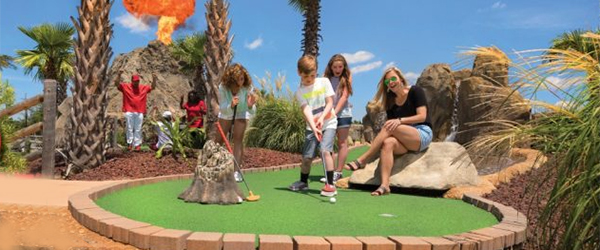 The whole family has fun at Lava Links mini golf... with a fiery volcano!